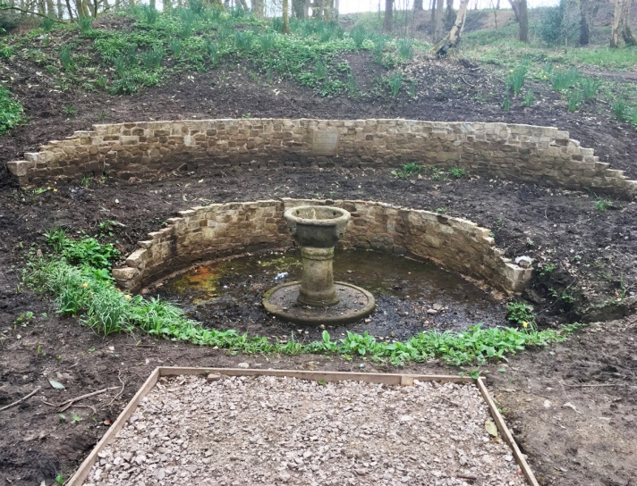 The restored fountain and new stonework before planting out.